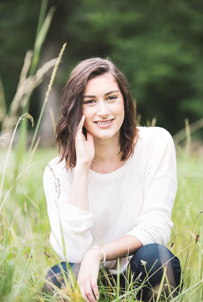 Senior portrait hay field by Monika Normand Photography
