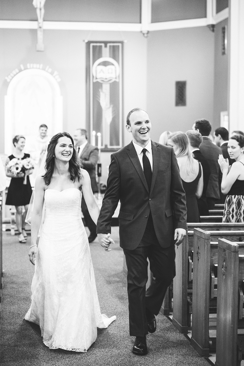 bride and groom down the aisle by Monika Normand Photography