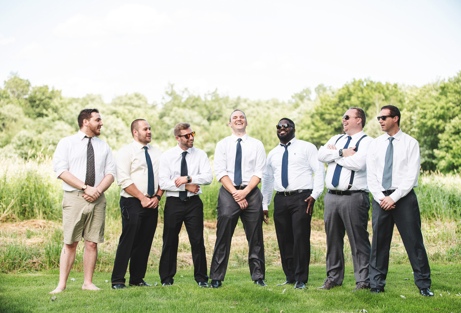 laughing groomsmen Granby by Monika Normand Photography